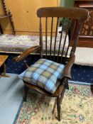 Antique spindle back arm chair.