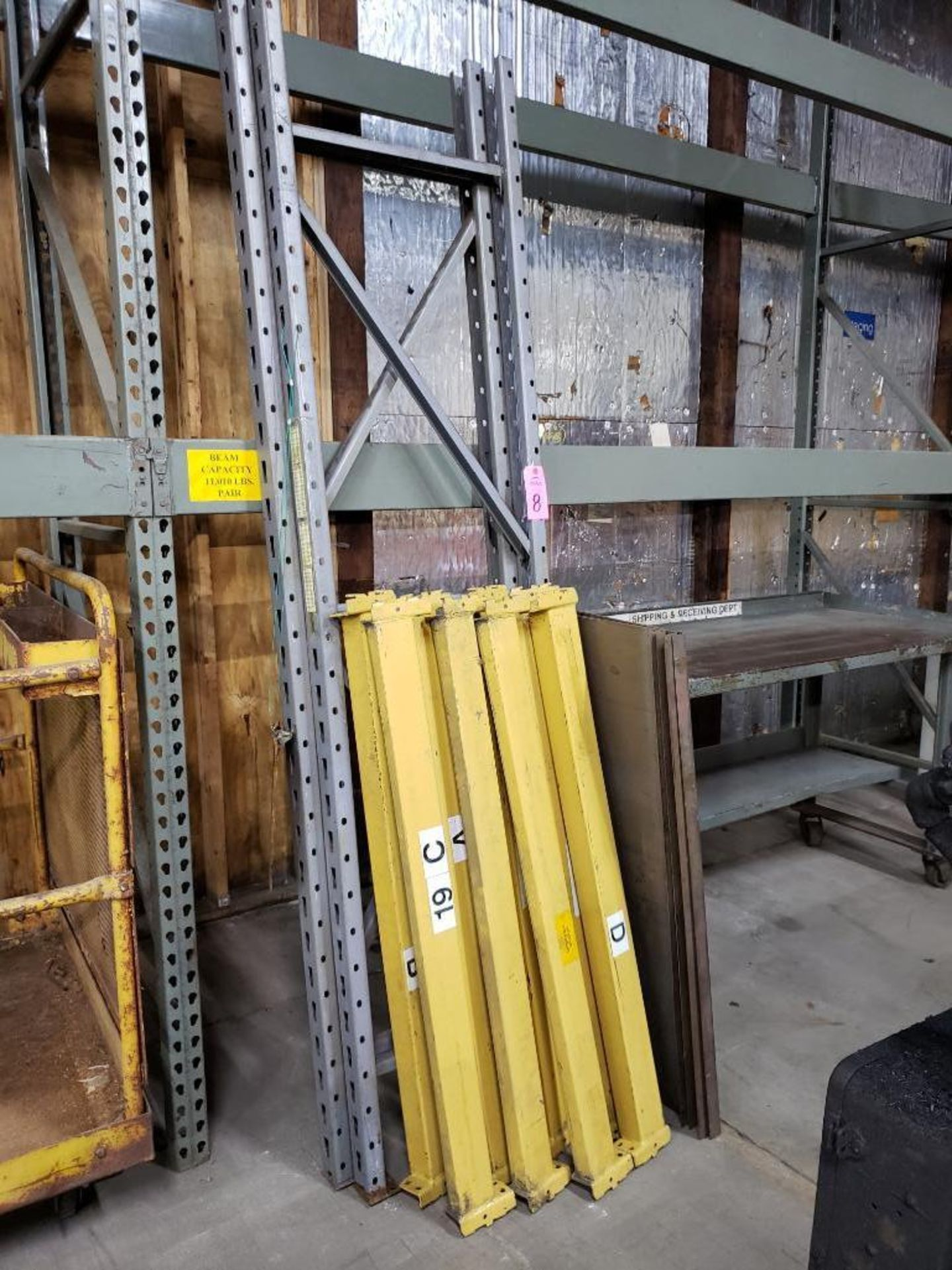 Lot 8 - 8' tall pallet rack section with 8 cross beams and steel deck.