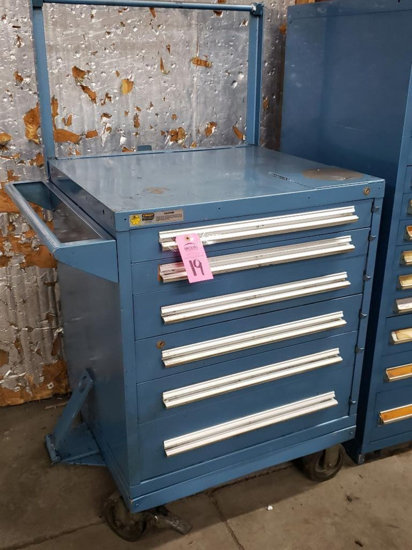 Lot 19 - 6 drawer Stanley Vidmar on casters. Overall dimensions 59.5Tx36Wx35D.