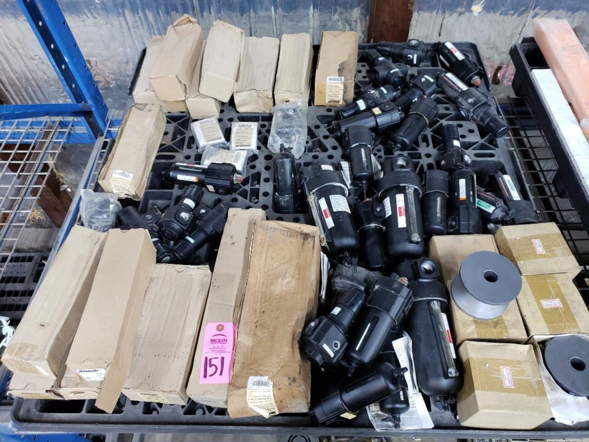 Lot 151 - Pallet of assorted pneumatic filtration and oil separator units. Most appear new, some in boxes.