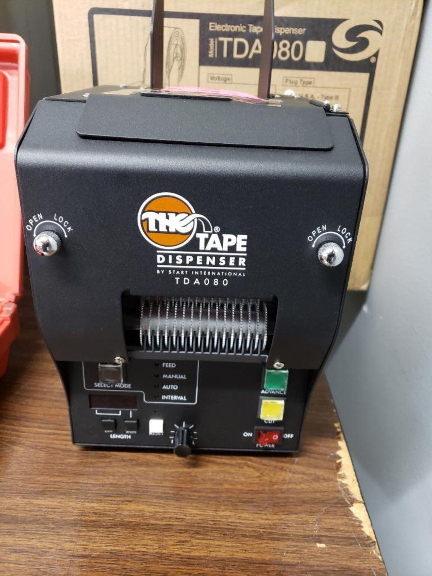 Lot 510 - The Tape Dispenser. Modle TDA080. New in box.