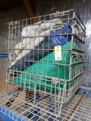 Drop down wire basket with assorted tarps.