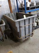 Rolling trash dump hopper.