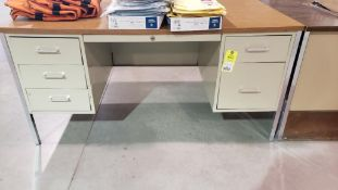 Metal office desk with wood laminate top.