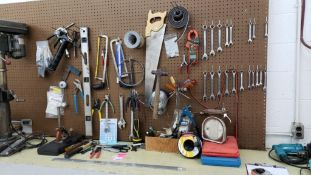Large assortment of tools on wall and bench. (Drill press and drills not included in this lot)