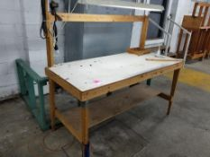 Wooden work bench with overhead light.