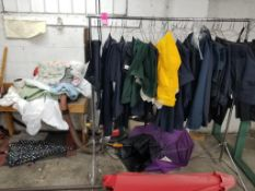 Lot of assorted safety apparel samples, clothing racks, shop vacuum, and more pictured.