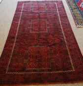 Blouch Rug, Decorated with allover geometric medallions on a red ground, 270cm x 150cm