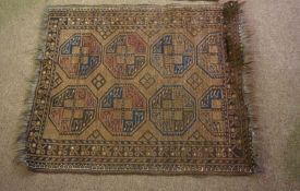 Persian Bluch Rug, Decorated with eight geometric medallions on a brown ground, 119cm x 94cm