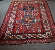 Koliaei Rug, Decorated with allover geometric medallions and motifs on a red ground, 210cm x 160cm