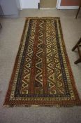 Persian Bluch Rug, Decorated with allover geometric motifs on a multi coloured ground, 239cm x