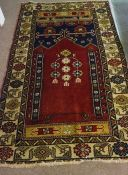Yahyali Rug, Decorated with floral and geometric medallions on a red and beige ground, 180cm x