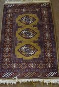 Turkman Prayer Mat, Decorated with three central geometric medallions on a red ground, 100cm x 65cm