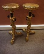 Pair of Gilded Blackamoor Torchere, (20th century) Raised on carved tripod supports, 95cm high, (2)