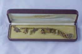18ct Gold Bracelet, with eight Oriental themed charms, mostly 18ct gold, overall weight 28.7 grams