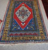 Tubbinar Rug, Decorated with a large geometric medallion on a red, blue and beige ground, 190cm x