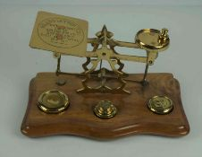 Set of Brass Postal Scales, with weights, raised on a wooden serpentine shaped base