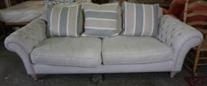 Chesterfield Upholstered Sofa, Would comfortably sit three people, with cushions, raised on turned