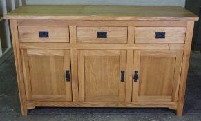 Modern Oak Sideboard, Having three small drawers above three cupboard doors, 83cm high, 138cm