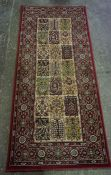 Persian Style Rug, Decorated with floral motifs on a green ground, label to reverse named