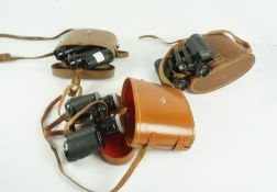 Three Pairs of Binoculars, Comprising of two pairs of 8 x 30 by Boots Empire, and a pair of