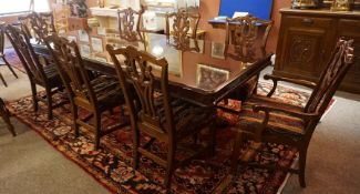 Reproduction Extending Dining Table with a set of Eight Mahogany Dining Chairs by Universal, the