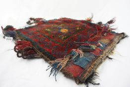 Two Persian Hand Knotted Saddle Bags, Decorated with geometric panels on red grounds, 45cm x 41cm,