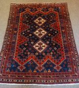Afshar Rug, Decorated with three central geometric medallions on a red ground, 215cm x 160cm