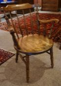 Stained Wood Smokers Chair, circa late 19th / early 20th century, Having a spindle back rest, raised