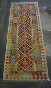 Kelim Style Rug, Decorated with six geometric medallions to the centre, 191cm x 71cm
