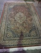 Persian Style Machine Made Rug, Decorated with floral panels on a red ground, 255cm x 165cm