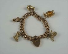 9ct Gold Padlock Bracelet, With five assorted attached charms, stamped 9ct to padlock and links,
