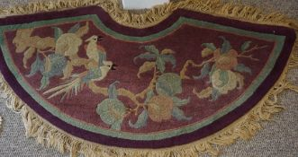 Tibet Rug, Decorated with parrots in foliage on an aubergine ground, 120cm x 35cm