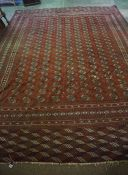 Turkoman Carpet, Decorated with multiple geometric motifs on a red ground, 340cm x 267cmCondition