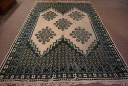 Tunisian Rug, Decorated with floral medallions and motifs on a white ground, 300cm x 200cm