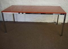 Contemporary Kitchen Table, Having a red resin detachable top, raised on a chrome style frame,