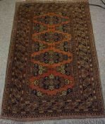 Afghan Rug, Decorated with geometric motifs on a rust ground, 120cm x 80cm