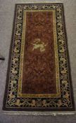 Chennai Silk Rug, Decorated with panels of goats on a rust, orange and brown ground, 120cm x 60cm