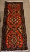 Hamadan Runner, Decorated with geometric motifs on a red ground, 140cm x 60cm