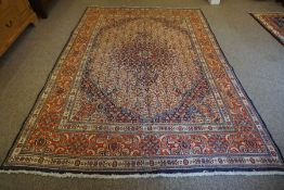 Louri Carpet, Decorated with allover floral motifs on a red and cream ground, 300cm x 210cm