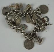 Silver Padlock Bracelet, With assorted attached silver charms, to include a Queen Victoria mounted