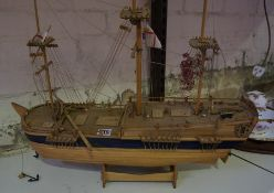 Model Wooden Boat, 47cm high, raised on a stand