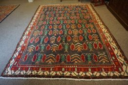 Mood Carpet, Decorated with panels of trees and geometric motifs on blue ground, with red and