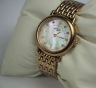 Rotary Gold Coloured Stainless Steel Ladies Wristwatch, Having a faux mother of pearl dial, with