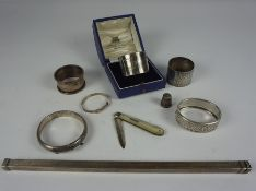 Mixed Lot of Silver, To include a rule case with London hallmarks, napkin rings, bangles, silver