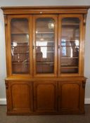 Victorian Oak Three Door Library Bookcase, Having three glazed doors to the top section, enclosing a
