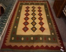 Persian Kilim Rug, Decorated with six rows of three geometric motifs on a cream, orange and red
