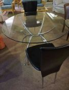Contemporary Glass Circular Table, raised on chrome style supports, 75cm high, 109cm diameter,