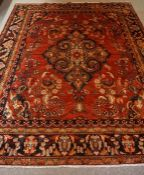 Persian Carpet, Decorated with allover floral medallions on a red ground, 330cm x 262cm
