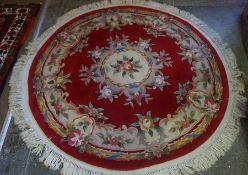 Chinese Style Rug, Decorated with Floral Medallions and Motifs on a Red ground, 180cm